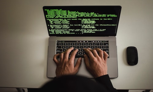 A person working on a laptop computer.